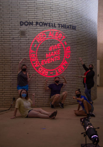 Don Powell Theatre Building Glows Red in Honor of #RedAlertRestart