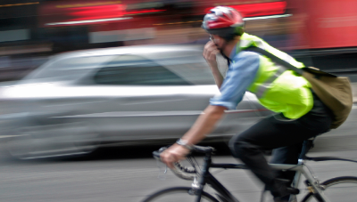 Man On Bike Wearing A Safety Vest